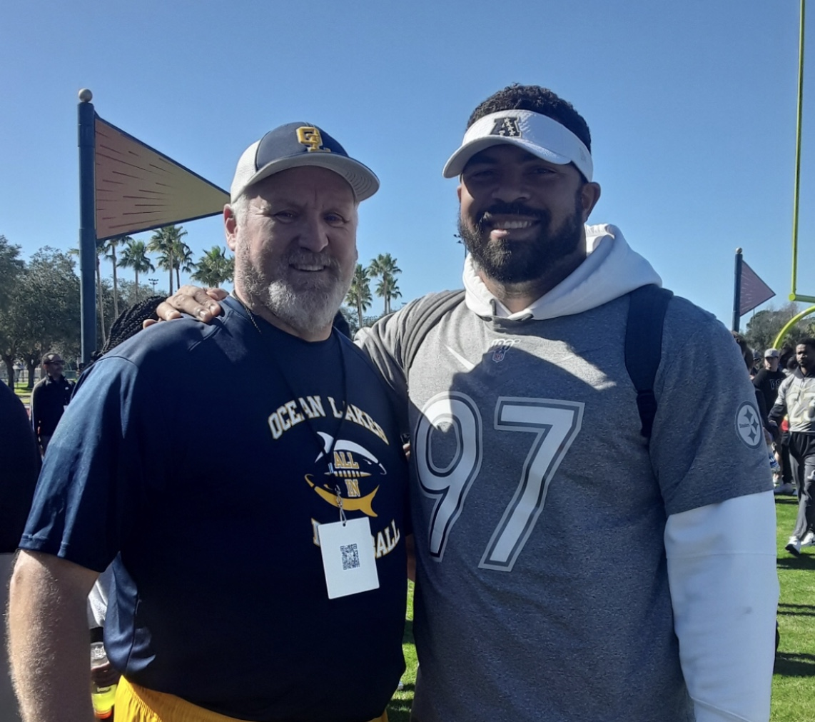 Coach Jones stands alongside Steeler's defensive end Cameron Heyward after practice at the Pro Bowl in Orlando, Florida.