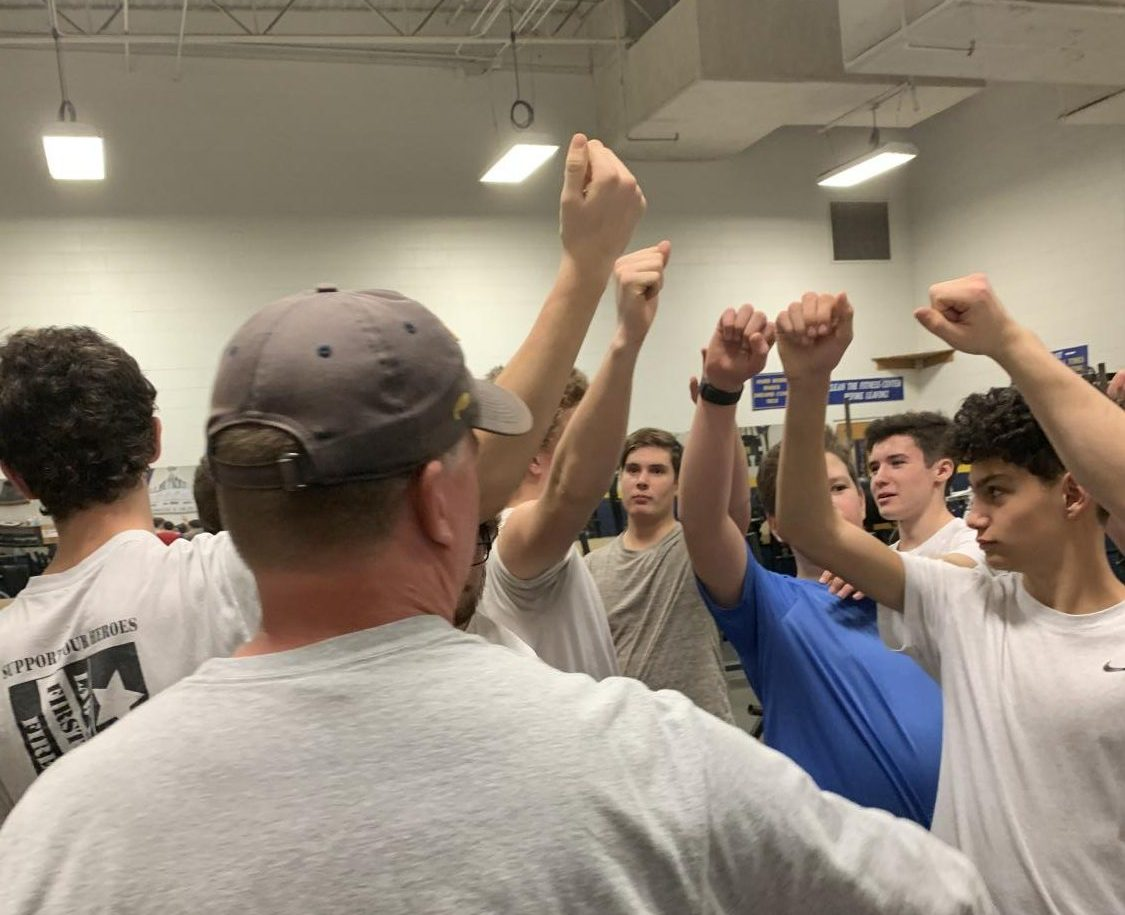 Ocean Lakes Boys Lacrosse Club puts hands in after workout on Jan. 21, 2020.