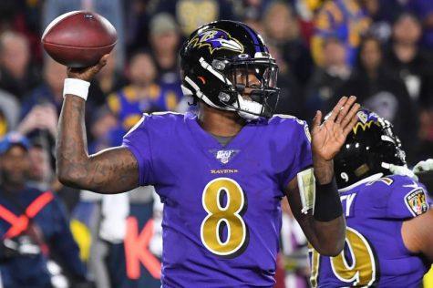 Lamar Jackson throws against the Rams November 25 in Los Angeles