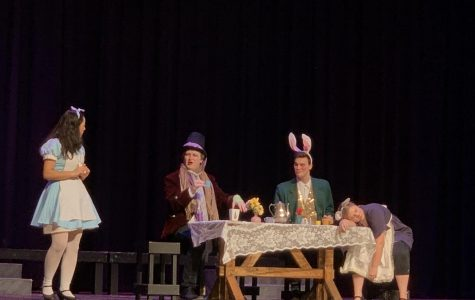 From left to right, Britanie Rivera plays Alice, Morgan Fine plays The Mad Hatter, Thomas Chick plays the Hare, and Brielle Bradt plays the dormouse.