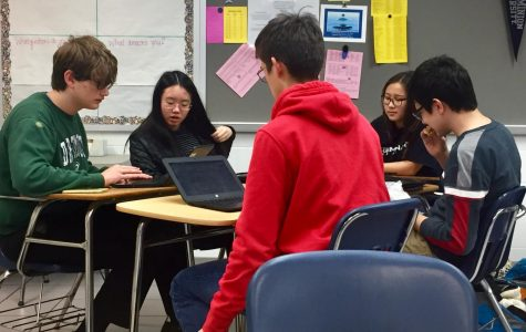 Student leader, Claudia Sung, edits member proposals for upcoming conference on Jan. 28, in room 157.