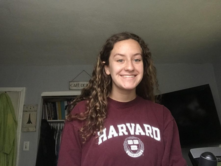 Sophomore+Celyna+Kemp+takes+a+photo+in+her+Harvard+University+gear+for+Future+Friday+on+March+27.