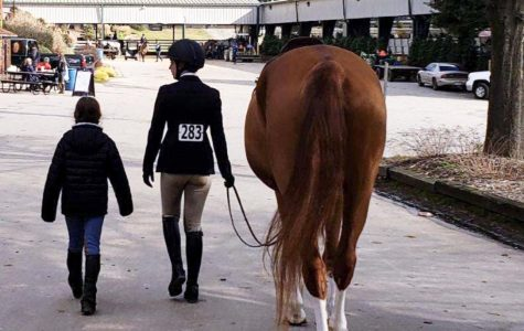 Skylar Fulcher walks Lina to arena during show at Triangle Farms in Raleigh, NC on Jan. 24,
