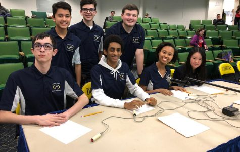 Scholastic Bowl team smiles for picture before final match in regional tournament on Feb. 1.