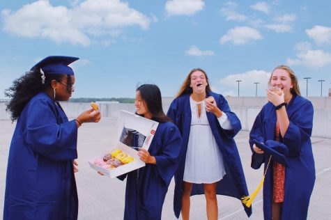 Seniors Faith Grant, Jaedyn Williams, Ryan Sherman, and Ally Grabarczyk celebrate their soon to occur graduation by eating free class of 2020 doughnuts on May 19, 2020.