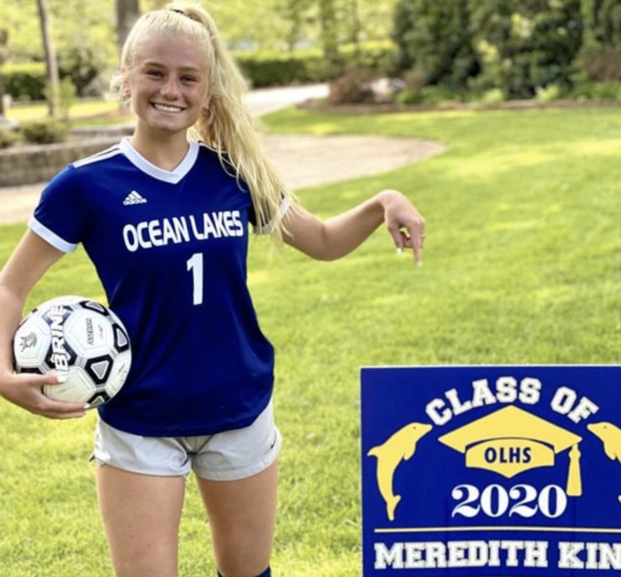 Senior+Meredith+King+stands+out+in+front+of+her+yard+with+her+graduation+sign+that+was+delivered+on+April+30+by+teachers+Gary+Felch+and+John+Kelley.