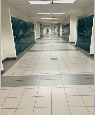 Teachers walk empty halls at the start of this year