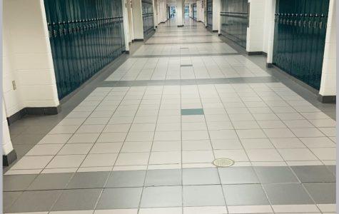 Teachers walk empty halls at the start of this year's school year.