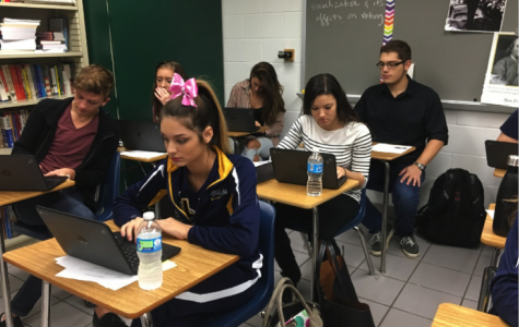 Alexis Buonfigli, Lizzy Lyons, Joseph Carter, Amber Woodard, Savannah Andrews, and Christian Glover, students in Darcy Pohl's first block A.P. Government class, actively use the Chromebooks to complete a focus question at the beginning of class.