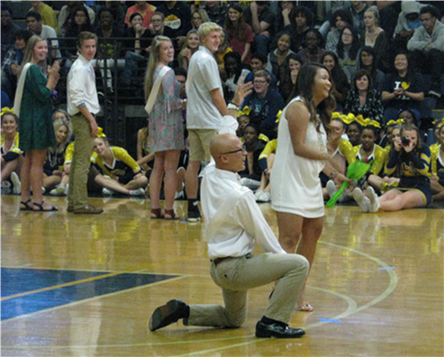 Seniors Eliza Navarro and Michael Puatu are introduced as  Homecoming court candidates for King and Queen at the  Homecoming assembly in Oct.