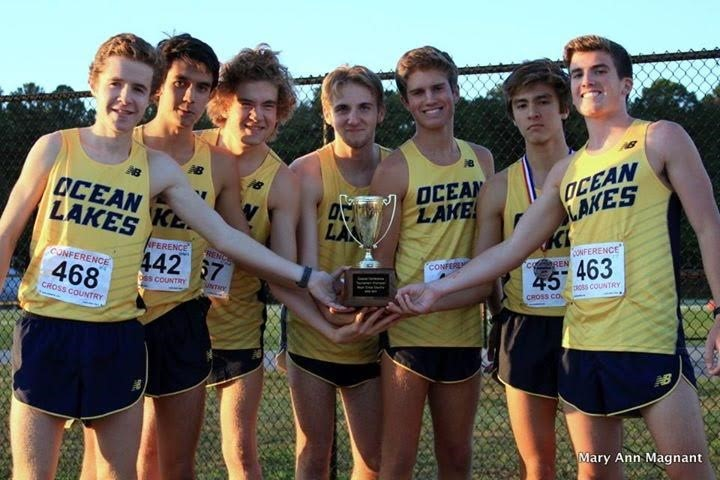 The+cross+country+boys+hold+their+Coastal+Conference+Championship+trophy+on+October+26+at+Kellam+High+School.+Left+to+right+sophomore+Will+Spollen%2C+senior+Sean+Burtner%2C+senior+Dillon+Schweers%2C+junior+Brent+Bailey%2C+junior+Jacob+Bushey%2C+sophomore+Tyler+Lipps%2C+and+junior+CJ+Reed.%0APhoto+by+Mary+Ann+Magnant.