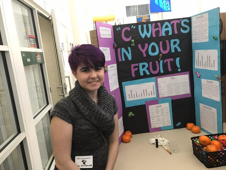 Sophomore Sam McManuels stands by her symposium project