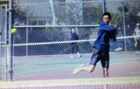 Brian practicing for a tennis match before spring break.
