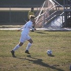 Bryce Riffle kicks soccer ball during game on March 16 at Ocean lakes High School against Northampton.