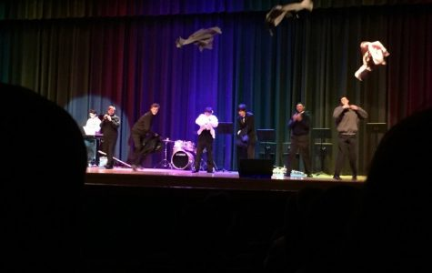 Senior contestant Adam Yi and his back-up band members rip off their coats during the talent portion of the Mr. Ocean Lakes pageant. Adam was awarded People's Choice.