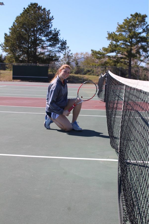 Kiersten posing next to the tennis net on the Ocean Lakes tennis court in March of 2017.