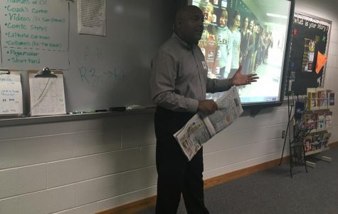 Rubama visited the staff during their 3A block on Wednesday, May 31 and talked to them about the importance of a good photo in journalism.
