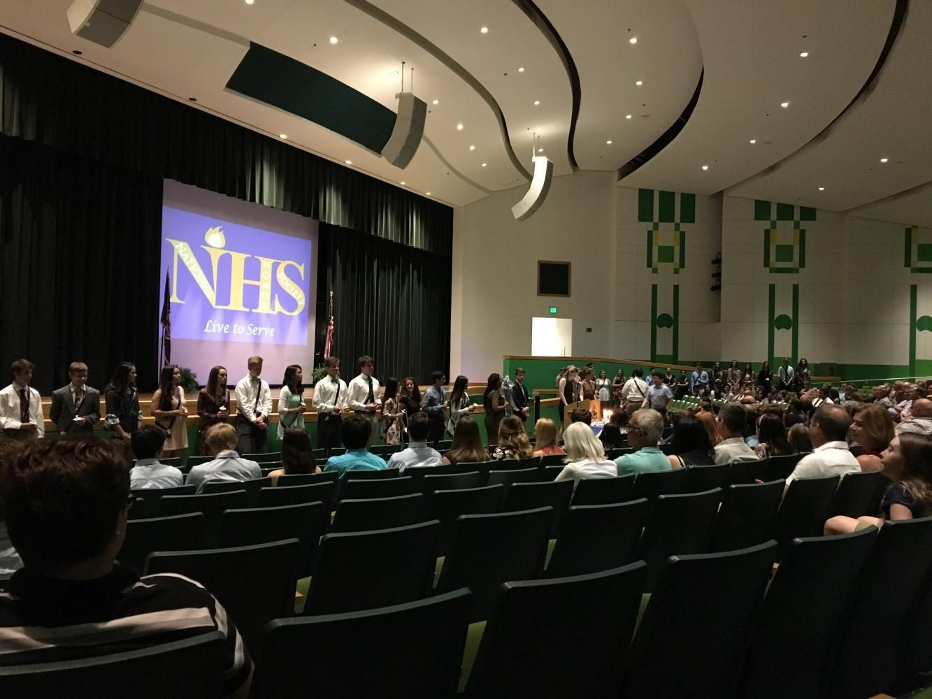 New+NHS+inductees%2C+parents%2C+and+teachers+gathered+in+the+auditorium+on+the+night+of+April+27+for+the+induction+ceremony.+
