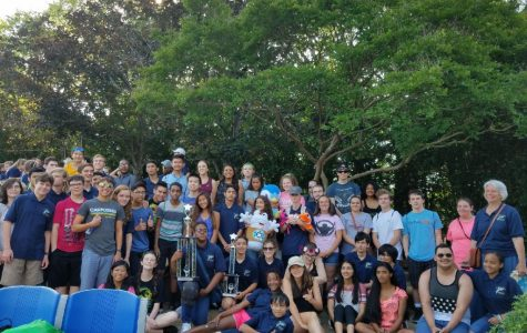 The orchestra at Busch Gardens holding their first place trophies. Picture taken by Makenna Miller.