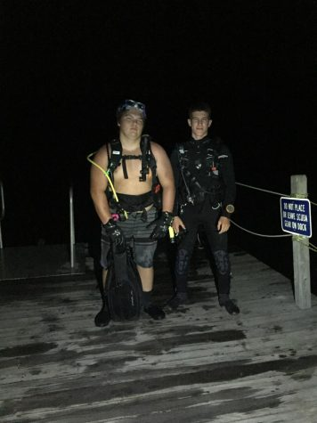 Yari (left) and Grant Manock (right) after getting out of the water on a night scuba dive.
