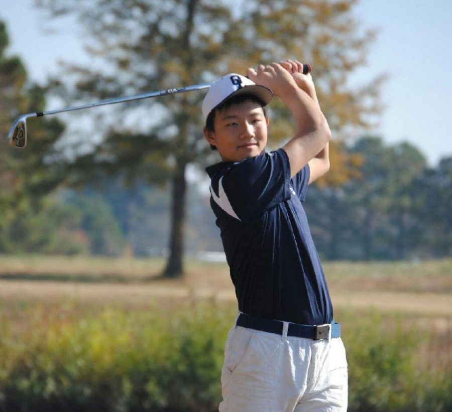 Senior Ralph Sun hits his approach shot at Stumpy Lake Golf Course.