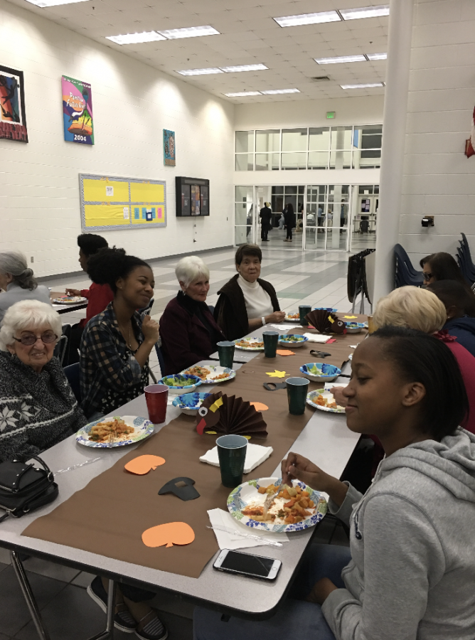 AVID students share a meal  together with Sullivan House residents.