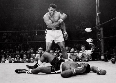 Muhammad Ali standing over Sonny Liston. Ali declared the winner.