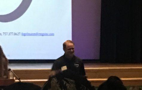 Fogleman speaks to hundreds of teens in the auditorium.