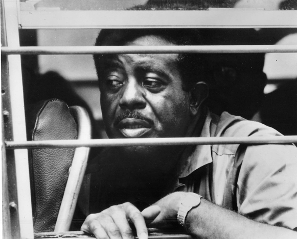 Abernathy looking through barred windows on a bus that was taking him to prison for protesting on capitol grounds in Washington D.C,  1968. Photo courtesy of Religion News.