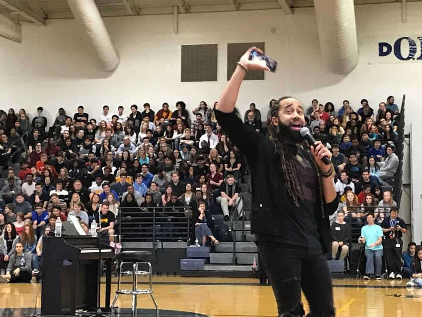 Shaun Derik talks to Ocean Lakes student body on concluding day of Founder's Week .assembly.