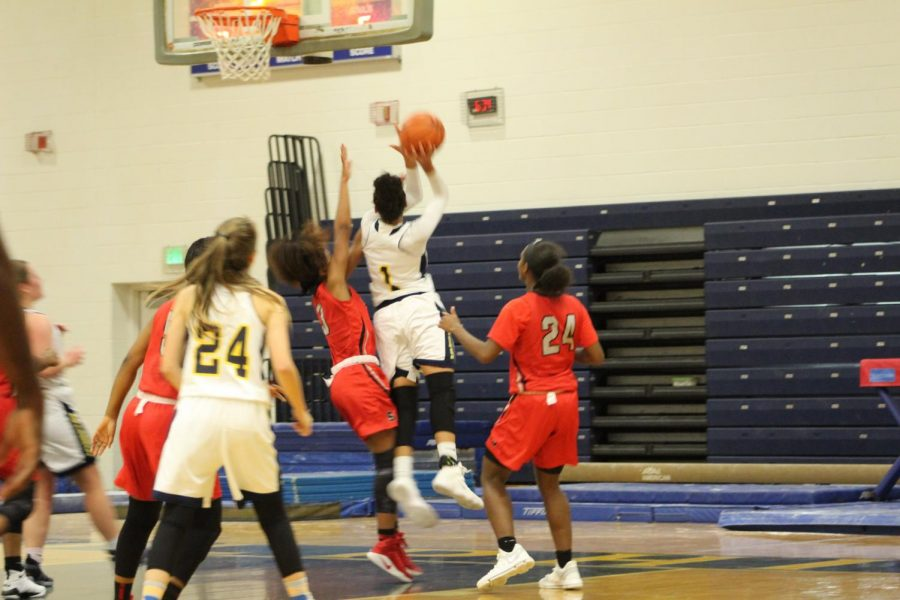 Junior, Kyla McMakin, posts up on the block for a layup against Salem High School on December 8th at Ocean Lakes.