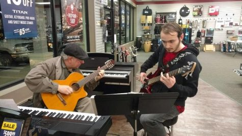 Depicts Tommy Shields playing the bass at Music and Arts store.