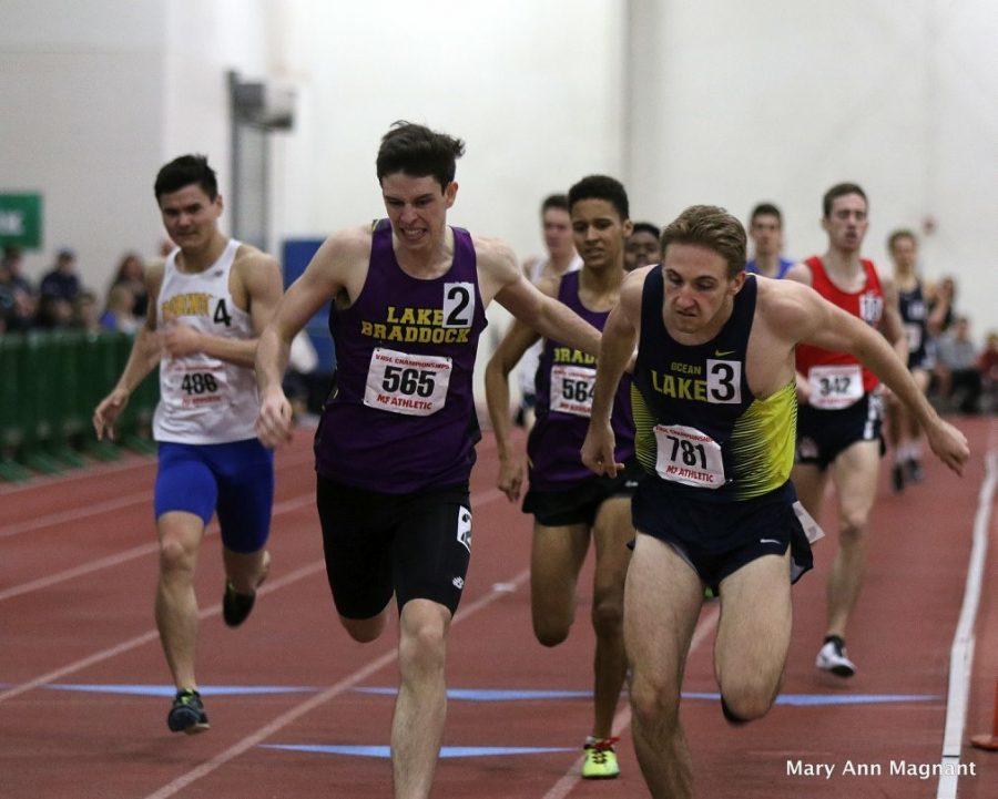 Brent Bailey wins the 1000 meter by leaning.