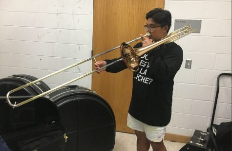 Romeo plays his trombone in the band storage closet.