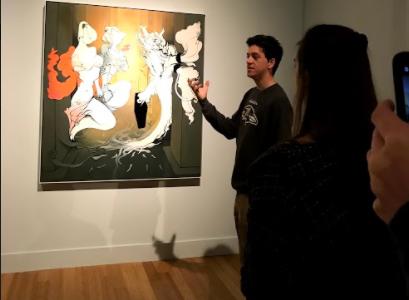 Photo of senior Sebastian Grant talking about a work of art.