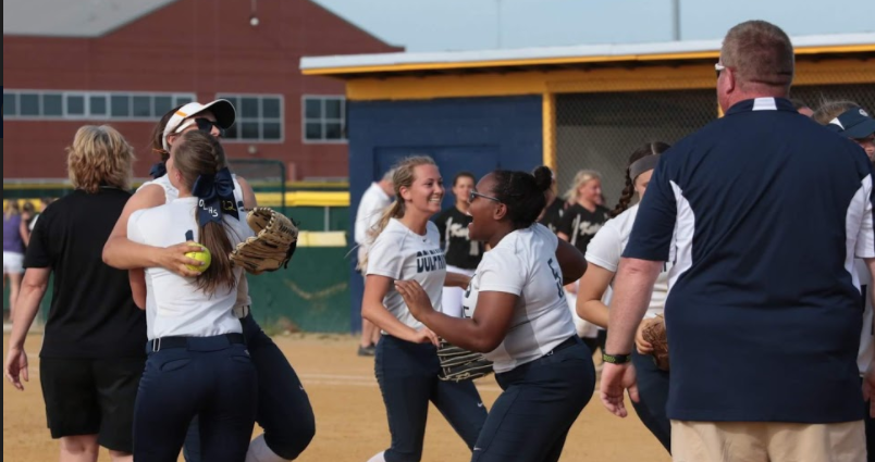 Abby Luerendo celebrates softball's victory over Kellam in April.