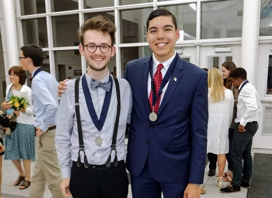 Seniors William Greer (left) and Sean Dimente (right) show off their medallions in the foyer at the conclusion of the ceremony. Both William and Sean received additional medallions at graduation, held on Sat. June 16, at the Virginia Beach Convocation Center. Photo courtesy of William Greer.