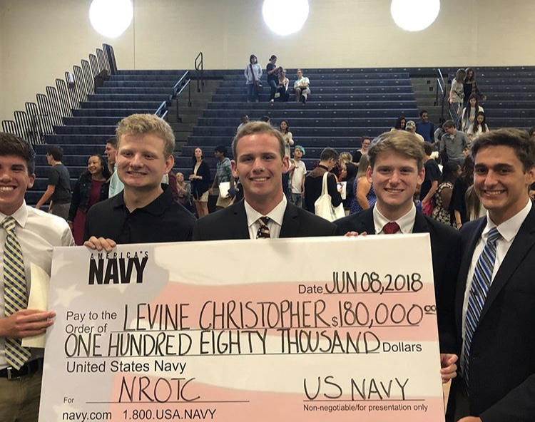 Seniors+Carl+Reid%2C+Danny+Connolly%2C+Chris+Levine%2C+Trey+Rodman%2C+and+Justin+Costello+pose+with+the+NROTC+Chris+was+awarded+for+college.