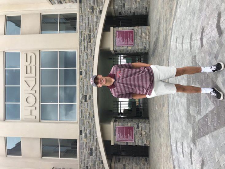 Rising sophomore Carson DeMartini standing outside the stadium of his future home stadium.