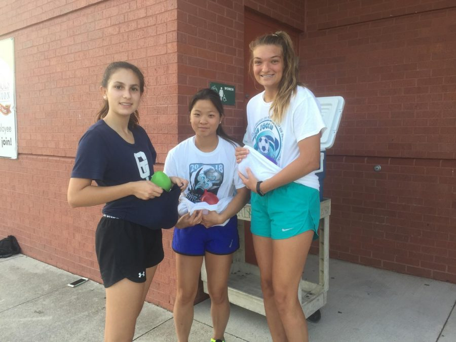 Juniors Deni Dimitrova, Jaedyn Williams, and Ryan Sherman volunteer at the OL soccer camp.