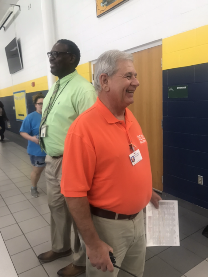 Security assistant Allen Johnson watching over students in the cafeteria during one lunch.