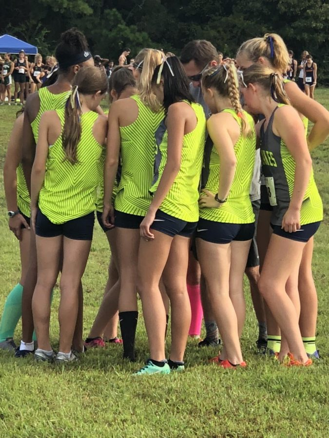 The+girls+cross+country+team+meet+before+their+race+on+Sept.+29+at+Bells+Mill+park.+