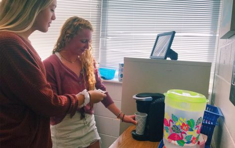 Juniors Sara Luper and Lauren Barakey make coffee with Darcy Pohl's Keurig before their AP US History class. Sept. 26, 2018