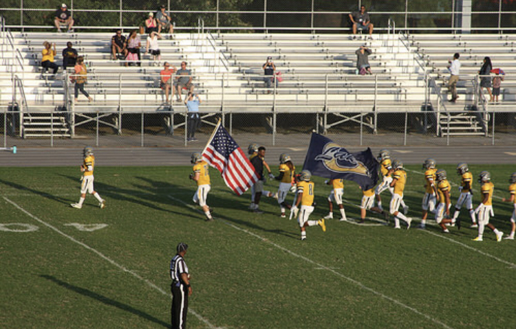 The junior varsity football team takes the field at Princess Anne.