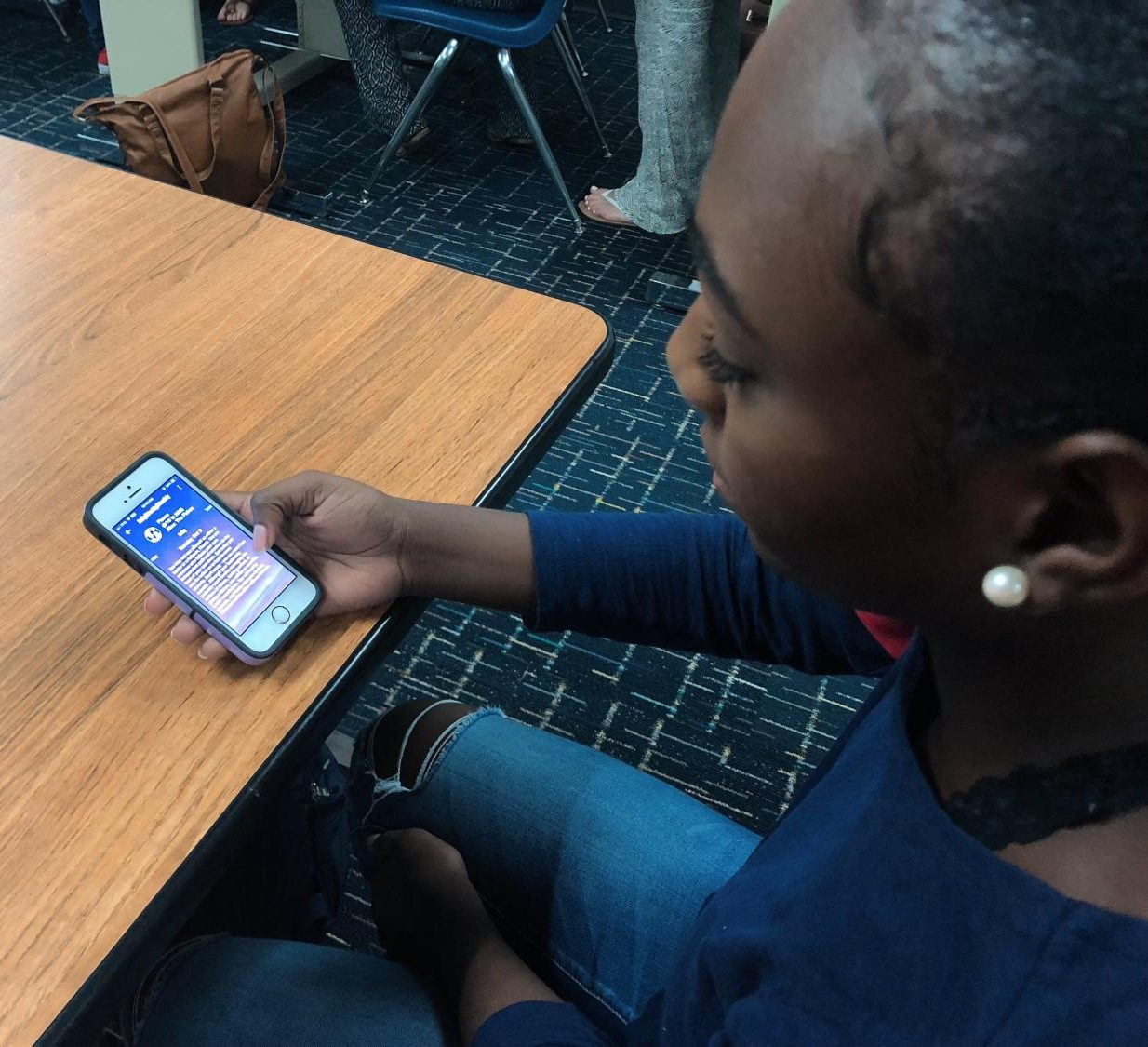 Junior Jaelese Peavy reads through dailly horoscope app during her free period on Oct. 10.