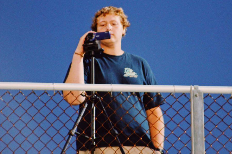 Jackson Ploeger taking photos at the Ocean Lakes vs Tallwood junior varsity football game