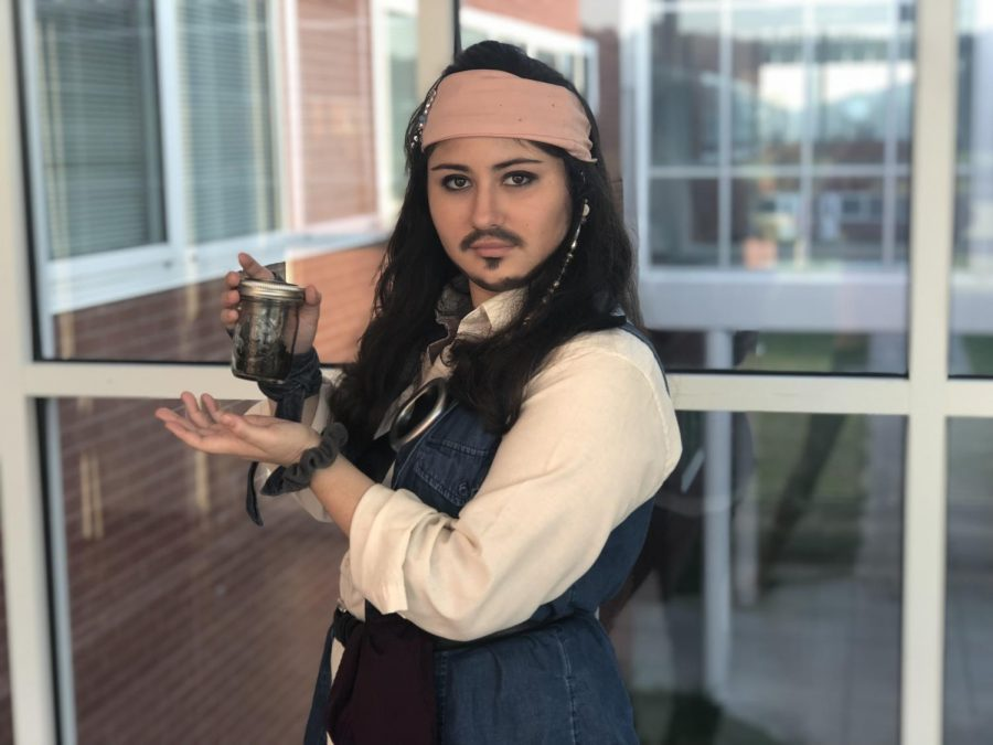 Senior+Sarah+Hester+poses+with+a+jar+of+dirt+as+Captain+Jack+Sparrow+from+Pirates+of+the+Carribean.+Taken+on+Oct.+5%2C+2018