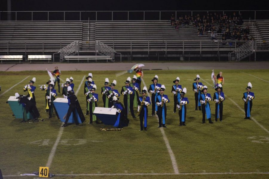 A section of marching band performs their show,