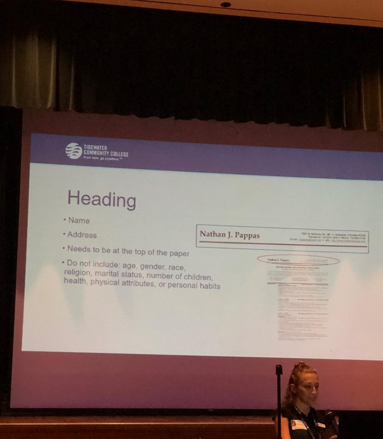 Portrays Kelsey Warren explaining what to put in a resume. Picture taken in the auditorium by Makenna Miller  october 10.
