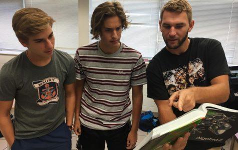 Pierce informing students (left to right) Alex Cigularov and Matt Escobar on Oct. 5